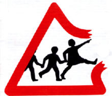 Original Education Otherwise logo, based on a UK traffic sign, perceived by many to show goose-stepping children breaking out of a triangle. Logo was later redesigned without militaristic overtones.